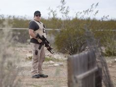 Men with AK-15s were stationed around the property