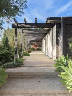 There are various pergola-framed walkways in the outdoor area of a California home.