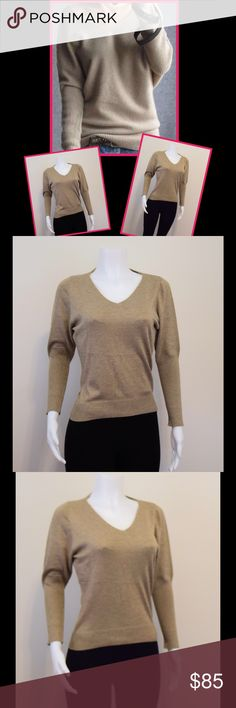 "Cashmere Dream V Neck Sweater Finish out the season in style in our Cashmere Dream sweater! Beautiful taupe soft cashmere v-neck sweater with partially ribbed sleeves. 100% cashmere. Available in S-2X. See size chart.  Mannequin is 35.5"" Bust, 26.5"" Waist, and 38.5"" Hips and wearing a small. Sweaters V-Necks"