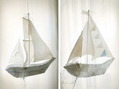 this little flying ship is made out of scraps of thread, cloth, cardboard, buttons and old newspaper.