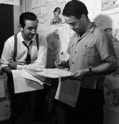Walt and animator Ward Kimball looking over sketches for Pinocchio, 1939