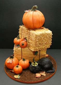Halloween - I made this cake for my son's 4th birthday.  His birthday is close to Halloween, and he really loves the theme.  The cake is pumpkin chocolate chip filled with pumpkin buttercream, and frosted with vanilla buttercream 'straw' (hand-piped). I made the pumpkins and kitten from rkt and modeling chocolate. I also made the leaves from modeling chocolate and added a cookie 'dirt' floor.