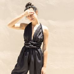 The Infinite Rope Jumpsuit allows for infinite possibilities, with cord ties that can be knotted in a multitude of different ways.