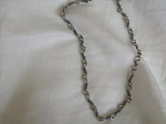 Handmade silver and gray wire wrapped chain with toggle https://www.etsy.com/people/Jashley79?