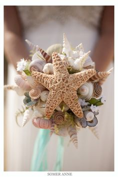 beach wedding; unique bouquet comprised of seashells and starfish