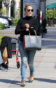 Jennifer Lopez wearing Christian Louboutin Paloma Large Tote Bag, Valentino Rockstud Camouflage Flats, Mother Looker Jeans in Songs of the Cowboys and Twenty Tees Turtleneck