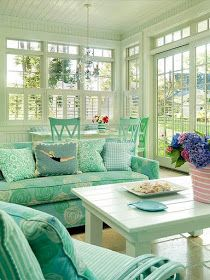 Love the porch/Florida room, shade of green and the swimmer, diver accent pillow.