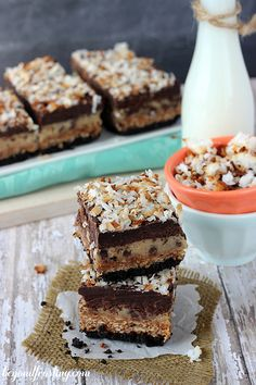 This chocolate cake is filled with adecadent coconut caramel cream cheese and frosted with afudgy dark chocolate buttercream. It is piled high with toasted coconut and drizzled with caramel and chocolate. You know it's going to be a good week when samoa recipes are involved. That means plenty of toasted coconut, caramel, chocolate and more …