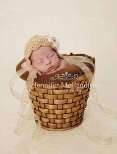 Colorado Springs newborn photography Jennifer McCandless Photography: Newborn in basket wearing bonnet from Heavenly Halos  http://www.facebook.com/?ref=tn_tnmn#!/JennysHeavenlyHalos