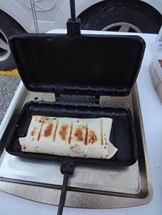 Our favorite campfire meal: Pie iron tortillas A little bit of taco meat, cheese, onions and peppers, wrapped up in a tortilla and toasted in a pie iron. Top it with salsa and sour cream and you have a camp dinner winner. Camping Food Pie Iron, Camping Dishes, Camping Stove, Camping Meals, Camping Recipes, Camping Hacks, Camping Cooking, Bbq Meals, Backpacking Recipes