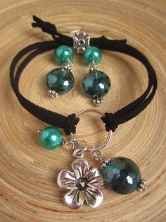 Leather flower charm bracelet and earring set, emerald, hypo allergenic earrings.  via Etsy.