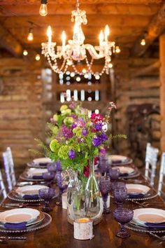 barn wedding with low ceilings and colorful floral centerpieces