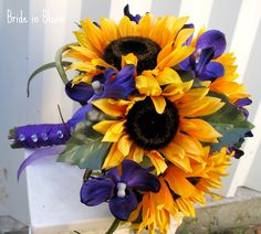 I think I have changed my mind. Purple and sunflower wedding for me. It's like being as different as night and day, yet they compliment one another so well.