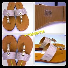 Summer Slip On Sandal Easy Breezy slip on and off thong flat buckle sandal.  In a golden tone with snake like material.  Soda Shoes Sandals