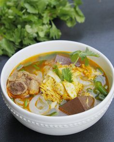 Clear Rice Spaghetti Soup with Crab Recipe (Bánh Canh Cua) from http://www.vietnamesefood.com.vn/vietnamese-recipes/vietnamese-noodle-recipes/clear-rice-spaghetti-soup-with-crab-recipe-banh-canh-cua.html