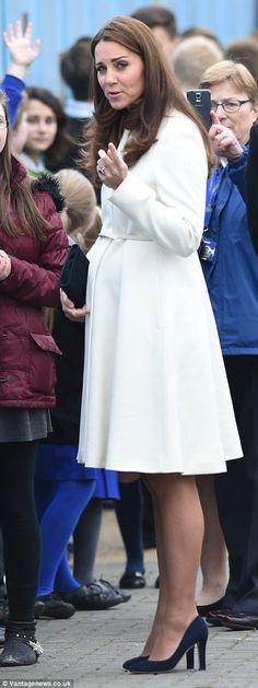 Duchess of Cambridge wears elegant coat to show off her bump #dailymail