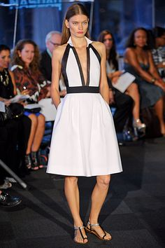 Carmen Marc Valvo Spring 2012 collection. White and black look sexy and fresh on a collared deep-v halter.