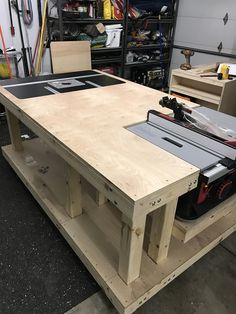 I made this table after looking at many different designs. My workshop is the 3rd stall of my garage. I wanted to have an assembly and workspace while saving space from a table saw stand and router table. Used Sketchup to design. Very happy with how it turned out. Currently working on hoses for dust collection.