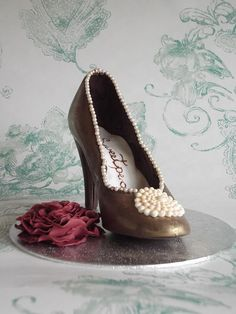 Chocolate candy shoe with edible rose decoration by Sweetpea cakes and Treats, via Flickr