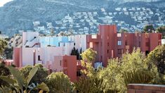 ArcDog Film: La Muralla Roja | Ricardo Bofill. @bofillarquitectura Image  ArcDog. #LaMurallaRoja #TheRedWall #RicardoBofill #Calpe #Alicante #Spain #Colourful #Pink #Blue #Red #Apartment #Housing #City #ArcDogFilm #Architecture #Architect #Film #ArcDog #Filmmaking #MonumentValley