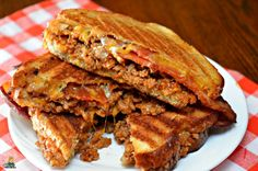 I used ground beef, onions, bar-b-que sauce, crumbled bacon, and cheese to make an ooey gooey BBQ Bacon Cheeseburger Grilled Cheese. Best grilled cheese!