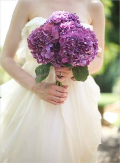 Perfect example of where not to hold your wedding bouquet. But the deep hydrangeas are lovely.