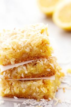 Ooey Gooey Lemon Coconut Butter Bars - These bars are ooey and gooey and have a delicious lemon flavor!  They are topped with a brown sugar butter coconut topping and are seriously AMAZING!   Easter kind of snuck up on me this year.  Here I am sitting at the computer on a Saturday night at mid