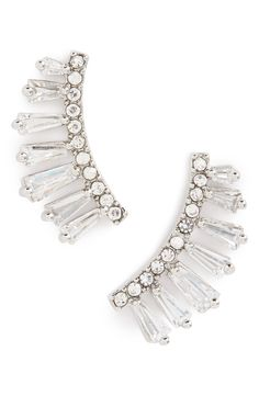 Adding a little glitz, glam and sparkle to the ensemble with these crystal ear crawlers.