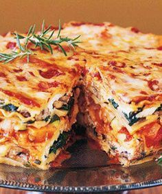 Mile-High Meatless Lasagna Pie - stacked with fresh vegetables, baby greens, aromatic herbs, three kinds of Italian cheeses and a rich, hearty tomato-basil sauce. It's ideal for a special-occasion dinner. Meatless Lasagna, Veggie Lasagna, Lasagna Noodles, Vegetarian Lasagne, Vegetable Lasagne, Spinach Lasagna, Roasted Vegetable Lasagna, Pasta Lasagna, I Love Food