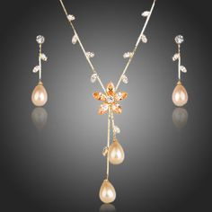 Pink Champagne Peach Orange Rhinestone Cubic Zirconia Necklace & Earrings Bridal SetThis is a beautiful and unusual Peach Orange necklace of high quality Swiss cubic Zirconia stones and rhinestones. Popular with wedding guests. Women's Jewelry Sets, Prom Jewelry, Jewelry Necklaces, Jewellery, Rose Gold Earrings, Bridal Earrings, Pearl Pendant Necklace, Necklace Set, Cubic Zirconia Earrings
