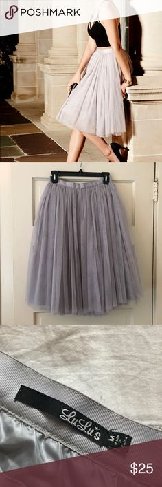 Gray tulle ballerina skirt Gray tulle skirt, super cute and in excellent condition! Side zipper with hook and eye. Adorable with a tank top or even a chambray shirt. Hits just below the knee for a classy look. Full and fluffy! Has some weight to it. Waist is fitted and not elastic. Lulu's Skirts A-Line or Full