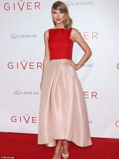 Taylor Swift in a lovely dress with her signature red lipstick looking amazing