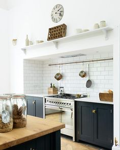 This metro tile and copper pipe combination is just perfect #deVOLKitchens