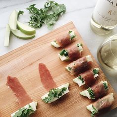 these prosciutto-wrapped apple bites are so easy to make. wrap a slice of prosciutto around an apple wedge, brie, and arugula to secure everything in place. be sure to pour yourself a glass of sauvignon blanc.