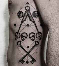 Lewis Ink inserted some skulls into this badass Mason tattoo.