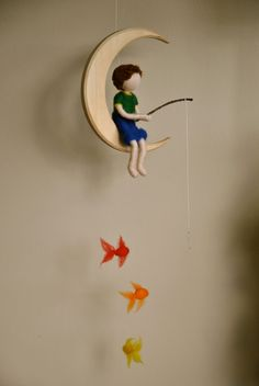 Boys Mobile Waldorf inspired needle felted : The fishing boy  in the moon with three fishes.. $65.00, via Etsy.