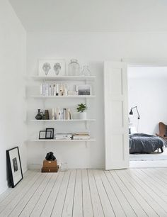 Scandinavian interior with light wood floors and white walls, open shelving - Top 10 tips for adding Scandinavian style to your home
