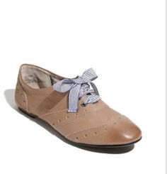 Flat oxfords that are super cute and go well with a light toned outfit.
