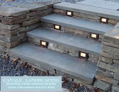 dry-stacked retaining wall and steps with lighting