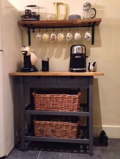 Coffee station...just figured out what I'm going to do to hang mugs...love this idea it looks like there's a small rod of some kind hanging from hooks from under the shelf.
