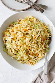 Vinegar Coleslaw is an excellent no mayo coleslaw recipe for those who love coleslaw but don't love mayonnaise. This vinegar based coleslaw is tangy, not overly Edamame, Vinegar Based Coleslaw Recipe, Apple Cider Vinegar Coleslaw, Slaw Dressing Recipe Vinegar, Coleslaw Recipe Celery Seed, Oil And Vinegar Coleslaw, Junk Food, Classic Coleslaw Recipe, Gastronomia