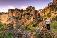 Buy Travellers man and dog looking at Ronda city in Spain by on PhotoDune. Travellers man and dog looking at Ronda city in Spain. Spanish People, The Perfect Getaway, Man And Dog, Europe Photos, Make New Friends, Andalusia, Life Is An Adventure, Most Visited, Spain Travel