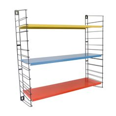Designed by A. Dekker, for Tomado, the Netherlands. Three shelves and two ladders, enamelled metal. Origination: the Netherlands, ca. 1950s