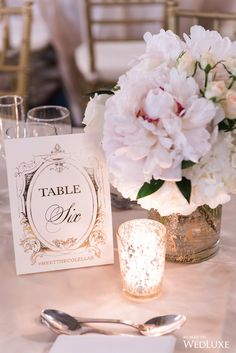 We love these gorgeous #tablenumbers, along with the candle glow! | Photography By: Ken Tan Photo | WedLuxe Magazine | #WedLuxe #Wedding #luxury #weddinginspiration #luxurywedding #stationery
