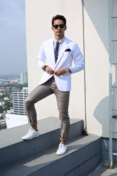 White blazer + striped dress shirt + bicycle print tie + pocket square + white sneakers