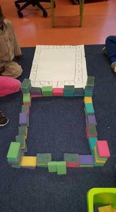 4 engineering challenges for kids (cups, craft sticks, and cubes!