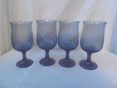 vintage kitchen pfaltzgraph, 4 blue  drinking goblets with flower like design.