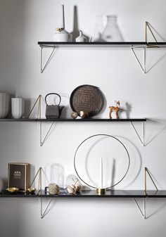 the shelf system by maze interior takes form depending where the brackets are placed; in the same way as a triangle's sides are based on two points. Corner Shelves, Wall Shelves, Shelving, Unique Shelves, Shelf System, Swedish Design, Shelf Brackets, Design Shop, Maze