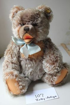 Antique STEIFF West German Zotty Bear. I have this one in white mohair I got when I lived in Germany in 1959. Unfortunately he has some damage, but I love him anyway.:)
