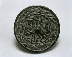 Mirror with horse-backed hunter 12th century Khorasan Cast bronze with moulded decoration Louvre, OA 6020